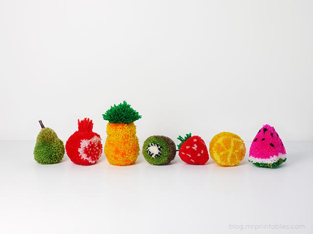 mrprintables-fruit-pompoms-on-table